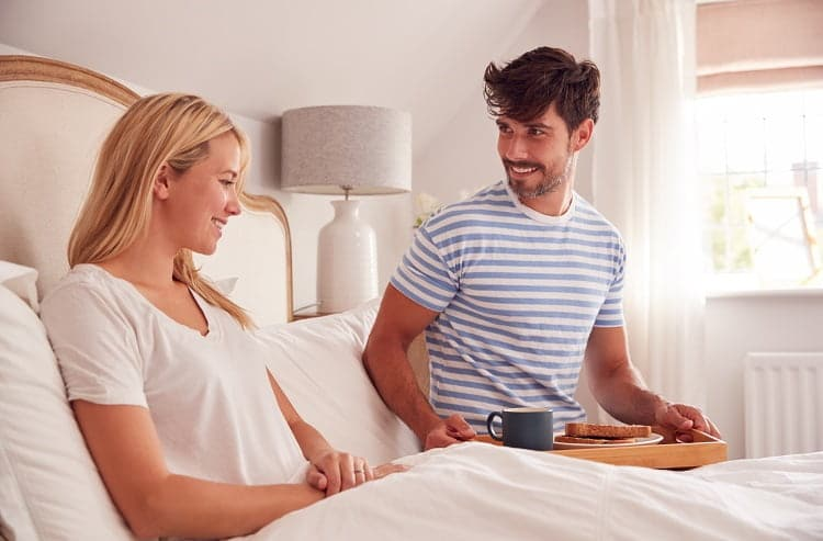 Husband Surprising Wife With Breakfast In Bed At Home